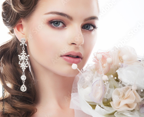 Portrait of beautiful young bride isolated on white background