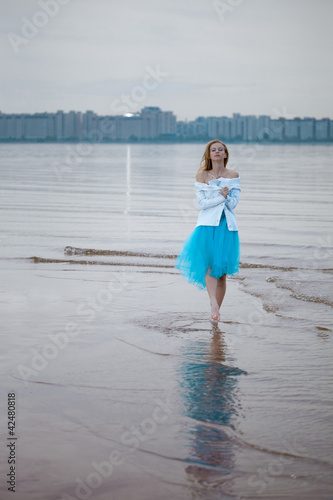 Lonely woman on the beach