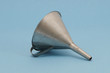 Ancient metal aluminum funnel on blue background