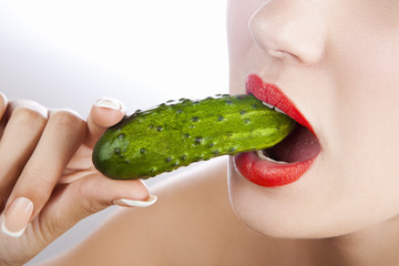 Sexy girl with cucumber