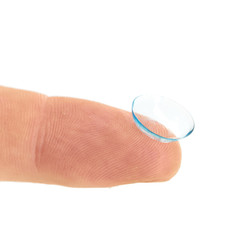 contact lens on finger isolated on white