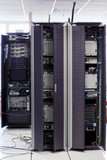 Telecommunication equipment  in a big datacenter.Cabinets poster