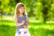 Cute little girl holding a flower