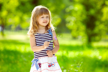 Cute little girl holding a flower