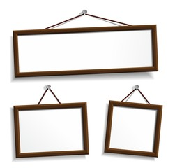 Wooden frames hanging on a nails. Vector
