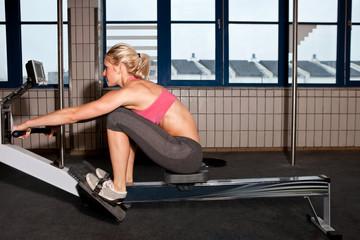 Woman On Indoor Rowing Machine