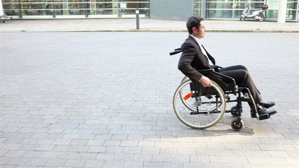 Handicapped business man using wheelchair
