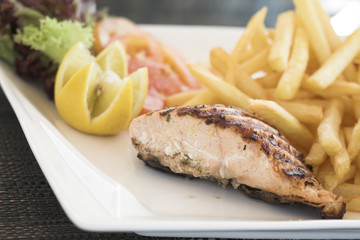 Healthy food, salmon steak and chips