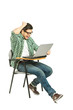 A shocked student sitting on a chair and working on a laptop