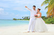 Bride and groom embracing on beach, Kuredu island, Maldives