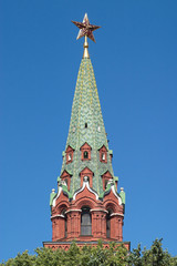 Moscow Kremlin Tower with red star closeup isolated on blue