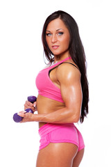 Portrait of sexy woman with dumbbells