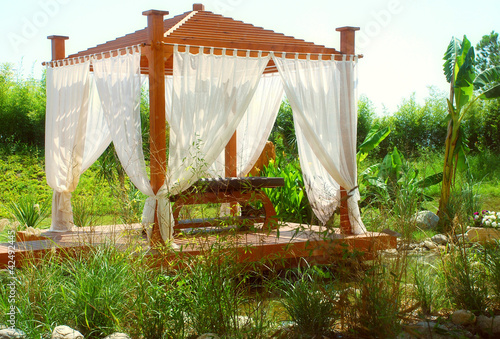 Romantic spa pavilion with curtain