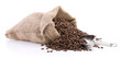 Burlap sack full of coffee beans with metal scoop