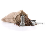 Coffee beans in a burlap bag with an metal scoop