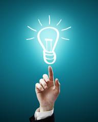 bulb light symbol on fingertip