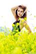 posing girl in yellow flowers