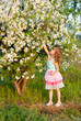 a girl near a flowering tree