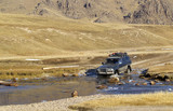 Car crossing small river in Northern Mongolia, Mongolia