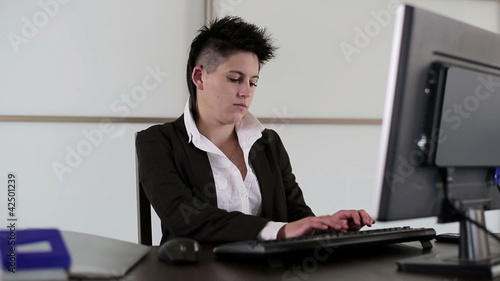 Young punk businesswoman during work in the office