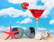 Beach composition of fashionable women's sunglasses and a