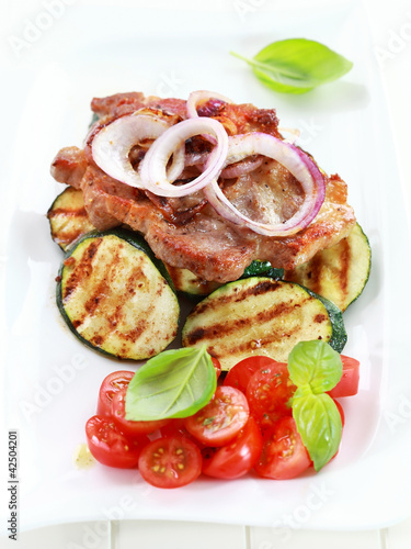 Pan-fried pork steak  with grilled vegetable