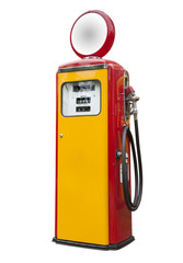antique gas pump in yellow and red, isolated