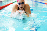 young girl swims breaststroke