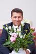 Geschäftsmann mit Blumenstrauß