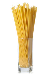 Long spaghetti in a glass on white background.