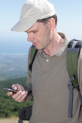 Hiker with mobile phone
