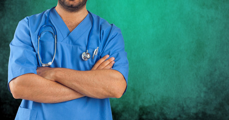 Male nurse on green background