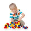 Child boy playing toy blocks