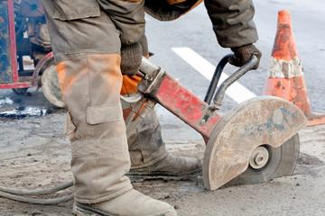 Cutting asphalt road for repair