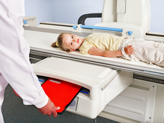 Child patient  in x-ray room.