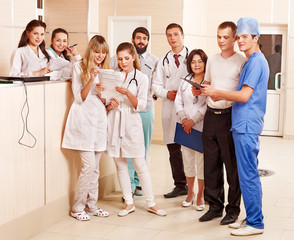 Group doctors at reception in hospital.