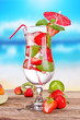 Strawberry mojito with blur beach on background