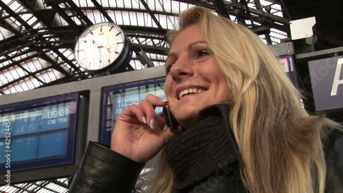 Business woman on the phone on central station outside