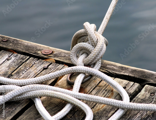 Knotted Rope Tied To Boating Dock