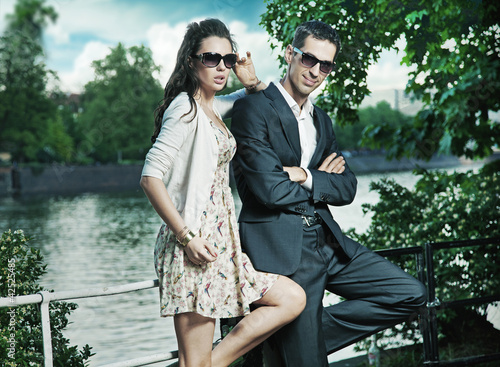 Young, smiling couple wearing sunglasses