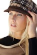 Autumn portrait of blonde beauty in hat