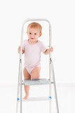 Cute baby climbing on ladder
