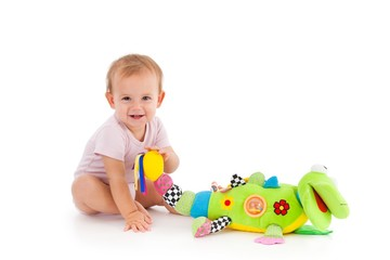 Happy toddler playing with toy
