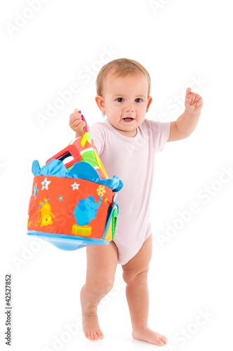 Lovely toddler holding toy in hand