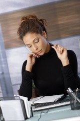 Ethnic businesswoman at desk