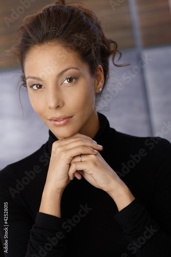 Portrait of young ethnic female