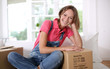Portrait of cheerful woman moving in new house