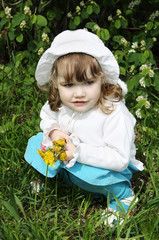 Beautiful little girl wearing hat with yellow dandelions