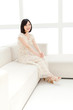 Beautiful young woman relaxing living room. Portrait of asian.