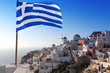 Santorini with Greek flag, Oia village
